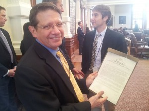 Harvey Kronberg with a Texas House resolution honoring 30 years of the Quorum Report.